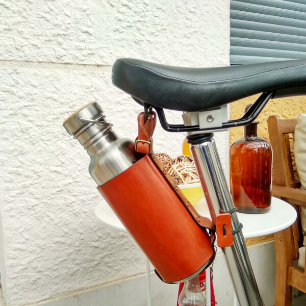 Brown bottle cage on saddle