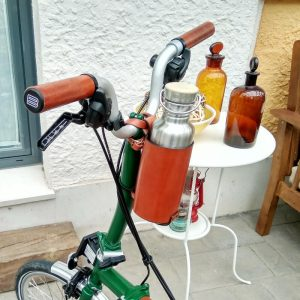 Brown bottle cage on handlebar